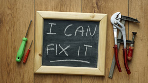 I can fix it written on a chalkboard with tools next to it
